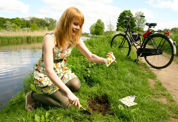 Sowing seeds for bees - cyclist sowing wildflowers